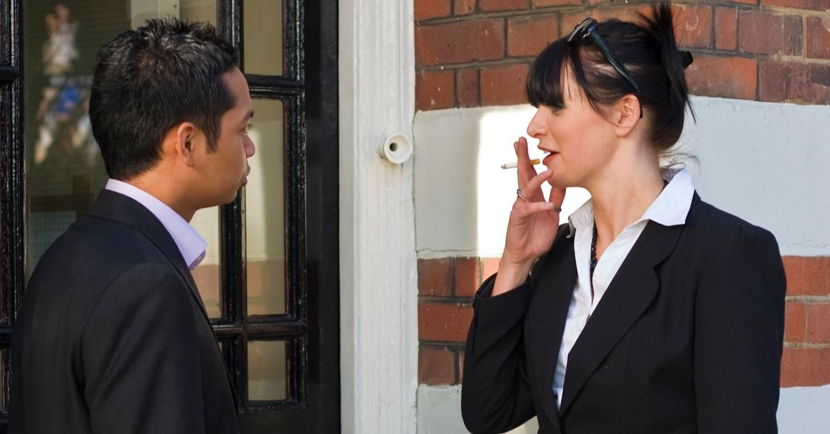 woman smoking man talking to her outside